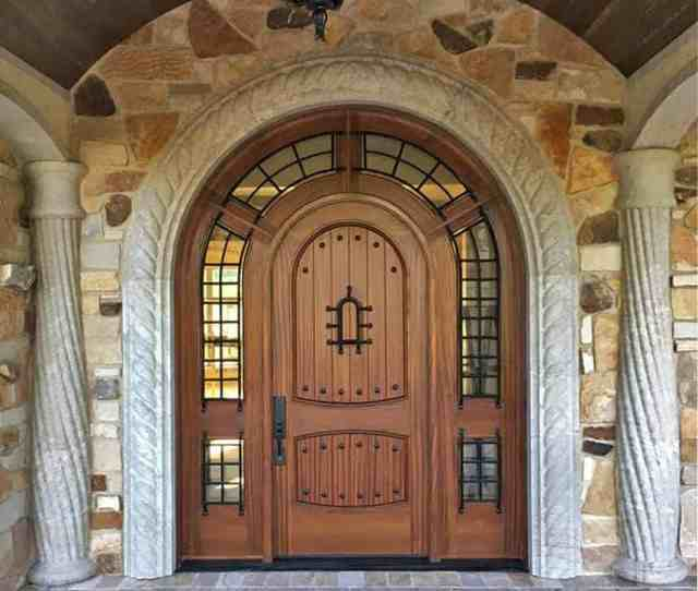 Knotty Alder Arched Front Entry Wood Door With Ornate Columns On Each Side
