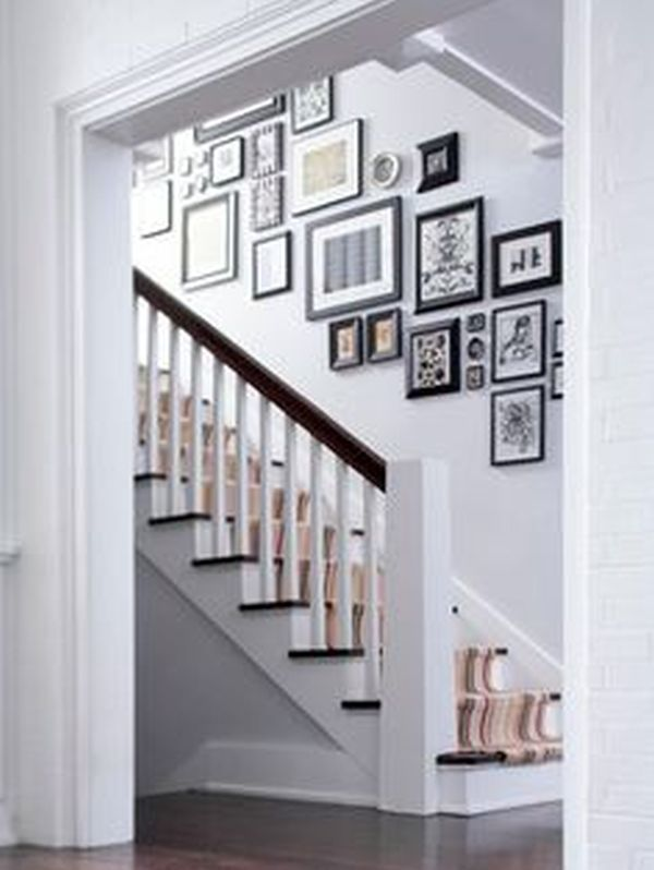 hang your kids' photos is the staircase wall