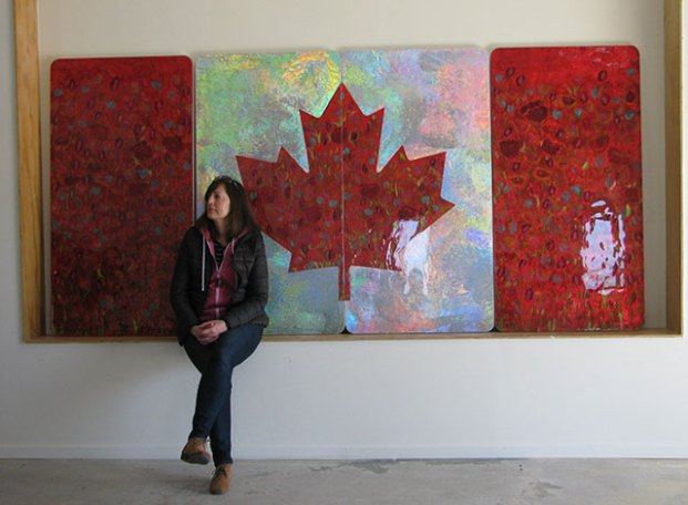 Bells Corners' visitor Wendy Nolan took a few moments to sit and view Sarah Moffat's dramatic flowers at the artist's open house on Saturday. Photo credit: Sally Smith.