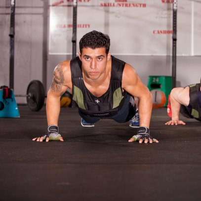 man-doing-weighted-vest-push-ups