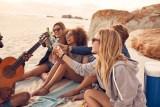 Multi-ethnic Friends Enjoying Beverages On The Beach