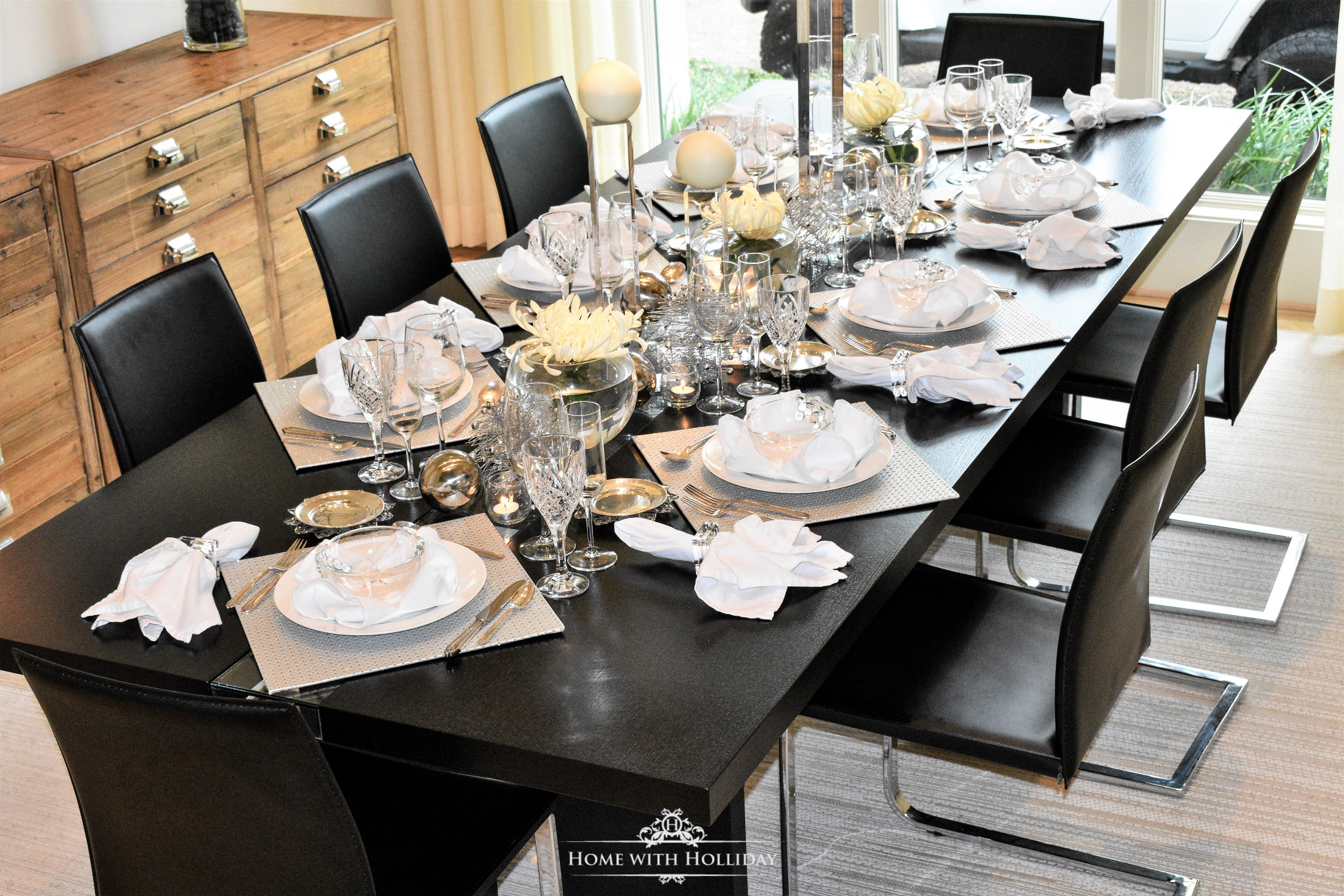 I loved working with their black custom made table because of the drama it offered for a backdrop. We started with the silver square placemats and laid them ... & Silver and White New Yearu0027s Eve Table Setting - Home with Holliday