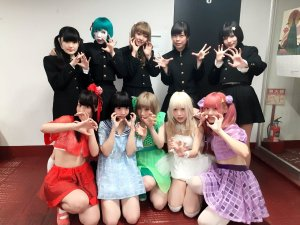 Japanese idol metal darkwave black metal idol group Necronomidol posing with Japanese idolcore yami-kawaii idol group Zenbu Kimi no Sei Da