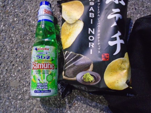 Some Japanese snacks: a melon flavoured soft drink and a packet of Wasabi flavoured crisps