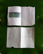 Enveloppe déchirée pergamine