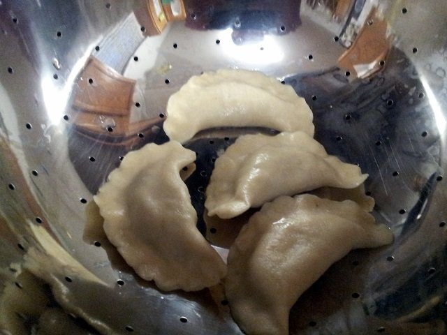 Drain pierogies in a colander without them touching