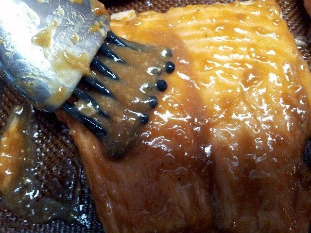 Brushing glaze onto salmon