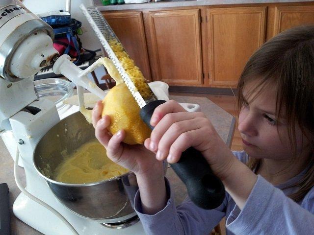 Seven year old zesting a lemon