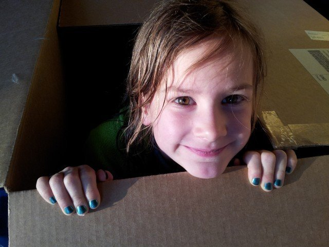 Little girl in a box
