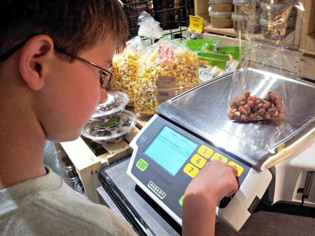 Mister Man can weigh and price the bulk foods like a pro
