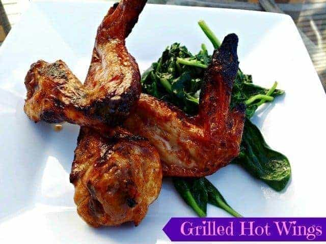 Grilled hot wings with sauteed spinach