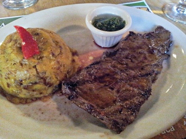 Restaurant plate of churrasco with mofongo