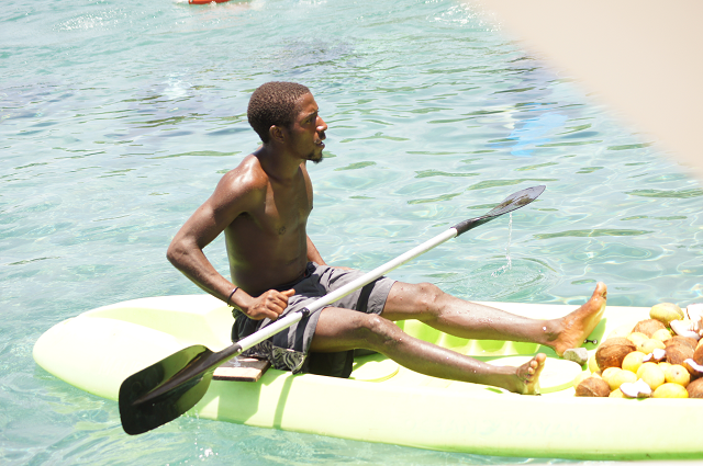 vendor on a kayak in St Lucia