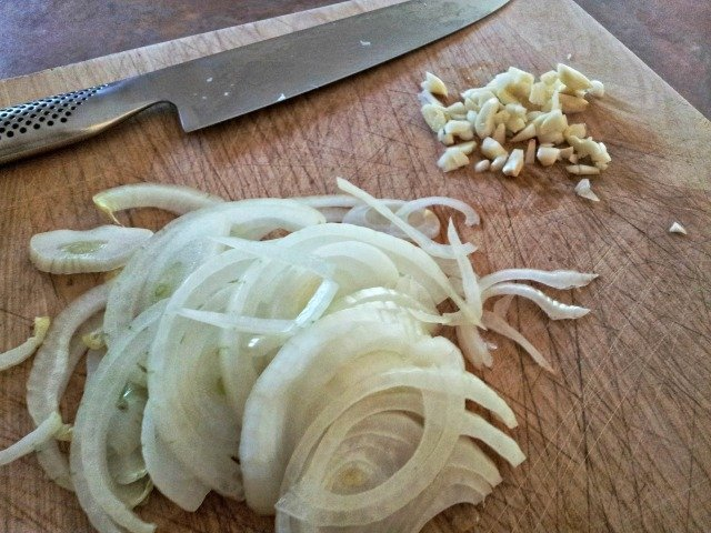 Slice your onions and garlic for the pulled pork