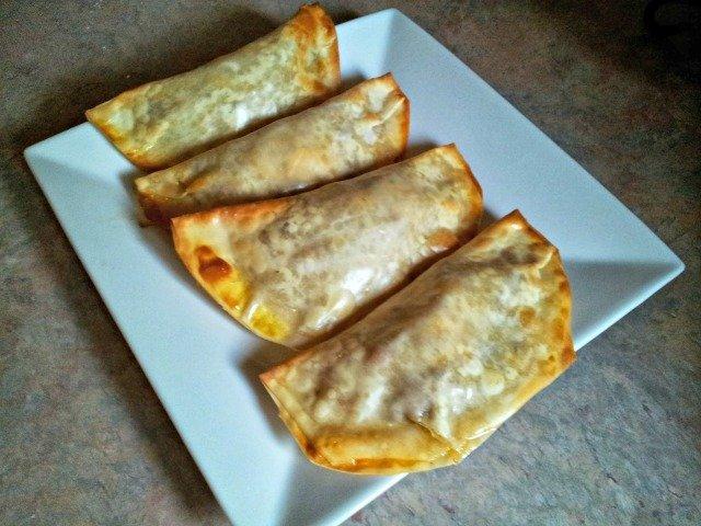 Four empanadas on a plate