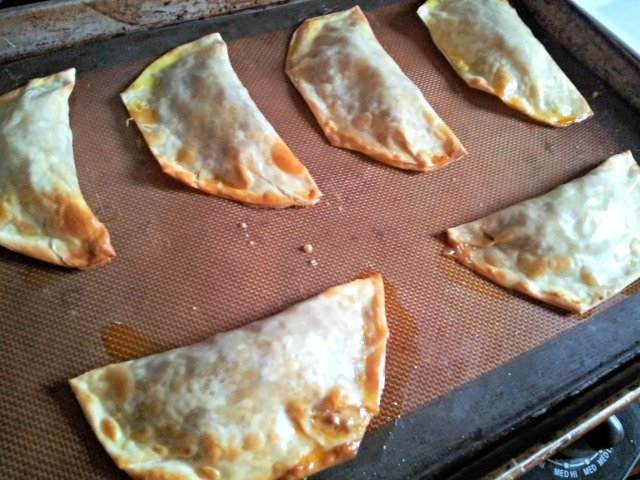 Baked empanadas are brown and crispy when done