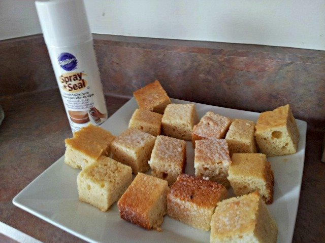 Spray seal the cake squares to keep crumbs from making them messy