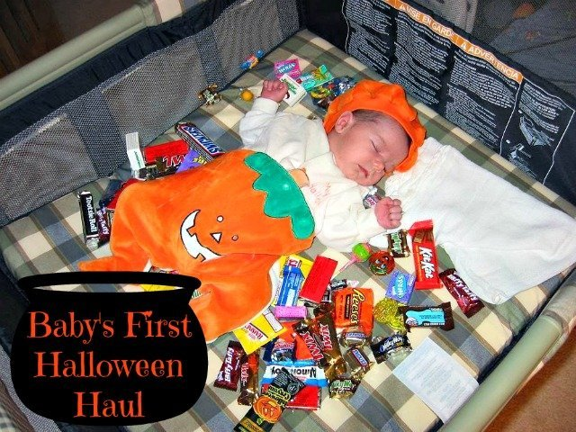 Baby sound asleep surrounded by candy