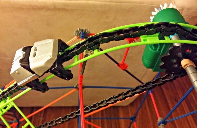 K'NEX roller coaster car climbing the hill