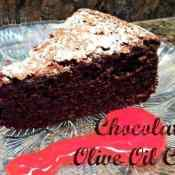 Chocolate olive oil cake plated with raspberry sauce