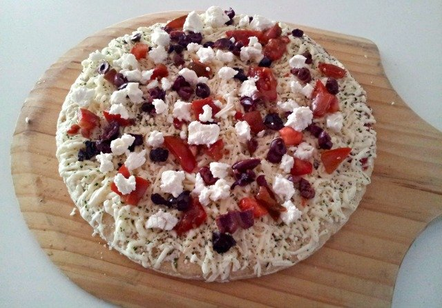 Goat cheese, tomato, and kalamata olives to make our game day pizza fancy and even yummier #shop