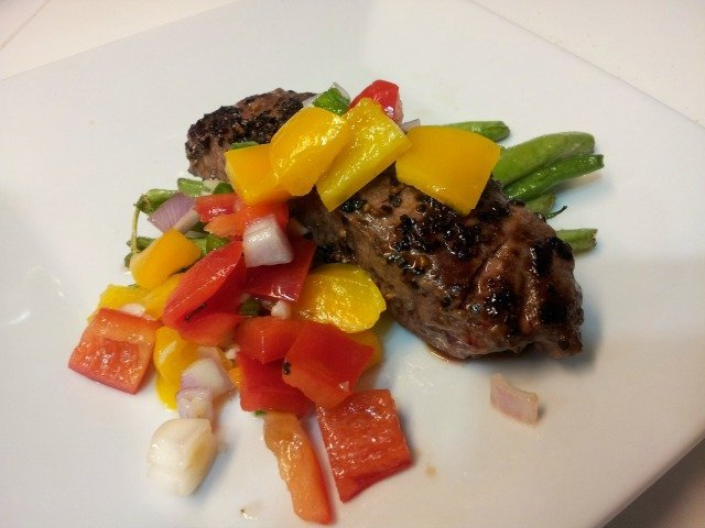 Relished Foods meal with peppercorn crusted flat iron steak, tangy bell pepper relish, and roasted green beans