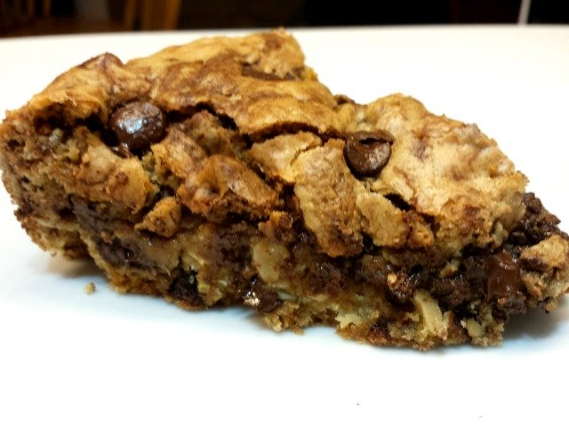 Enjoy a slice of chocolate chip oatmeal skillet cookie