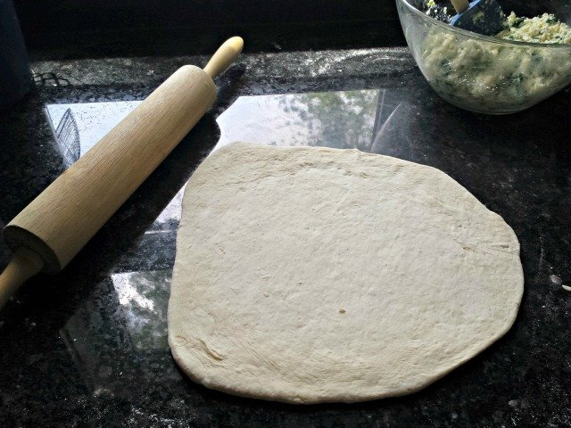 Roll out your dough for calzones to 10 inch circles
