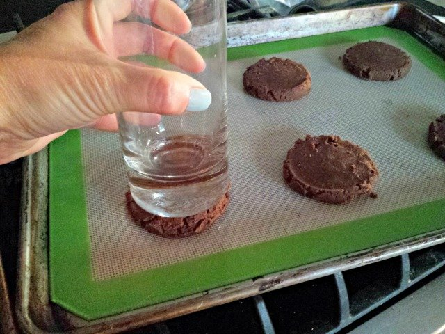 Flatten cookies for ice cream sandwiches with a glass