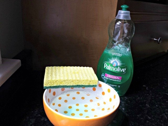 Steaming water with a little Palmolive removes soap scum