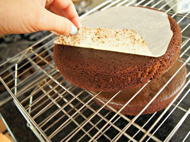 Remove parchment paper from bottoms of cakes once you turn them out