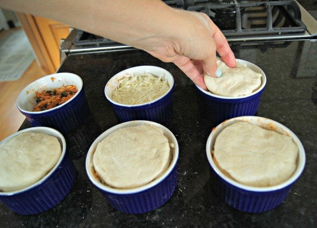 Adding biscuit dough is the last step before baking pizzakins