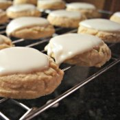Glazed chewy lemon cookies on the cooling rack