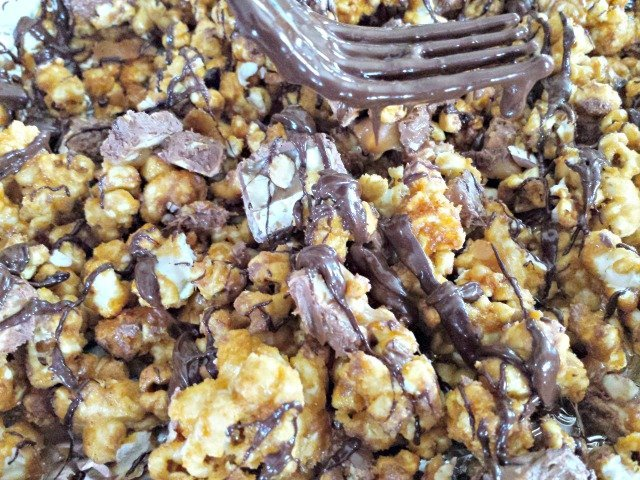 Drizzling snickers popcorn