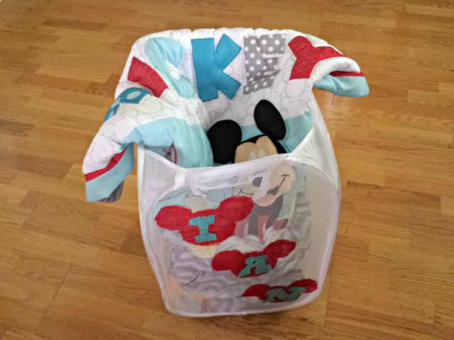 Add gift to the inside of personalized Disney gift hamper