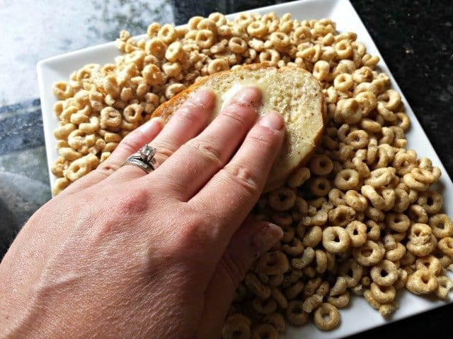 Gently press bread into cereal