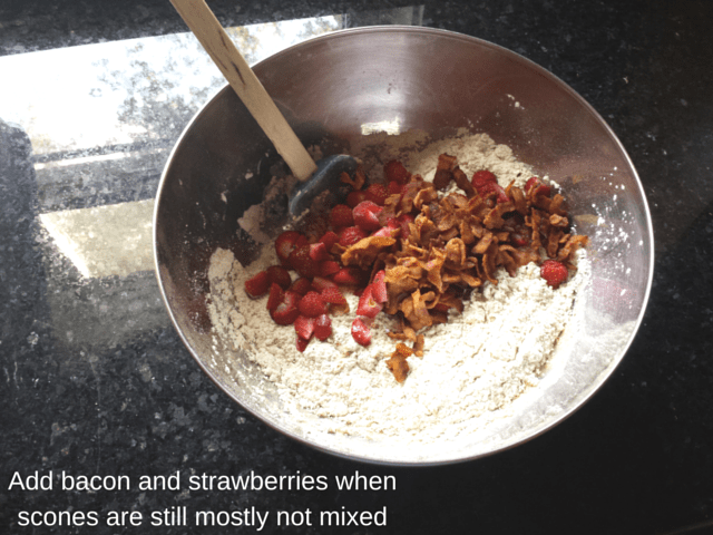 Adding bacon and strawberries to scone dough