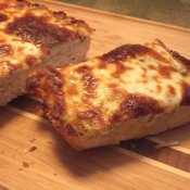 Slice of cheesy garlic bread