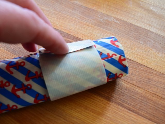 Loosely wrap two layers of duct tape to create the top to your pouch