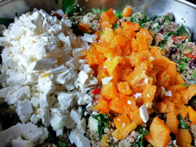 Add feta and butternut squash to harvest quinoa salad and stir