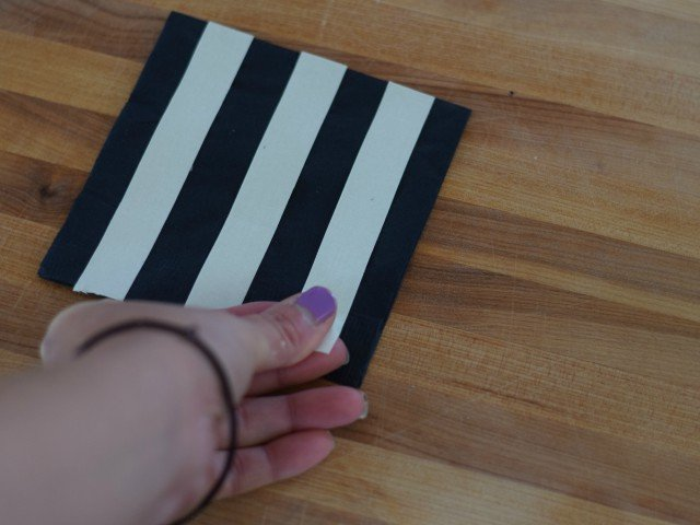 Apply washi tape in even strips across napkin
