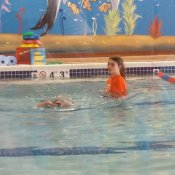 Enjoying swim lessons at Goldfish swim school