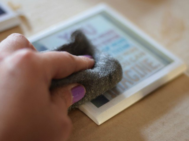 Use supefine steel wool to carefully sand between each Modge Podge layer