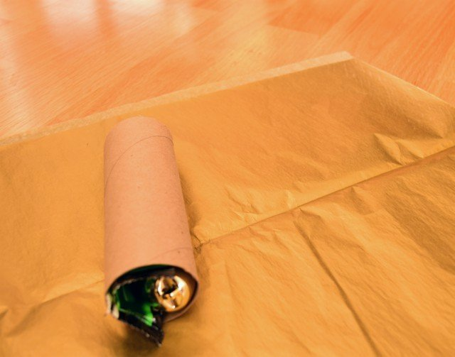 Fill cardboard rolls with gifts and place on tissue paper