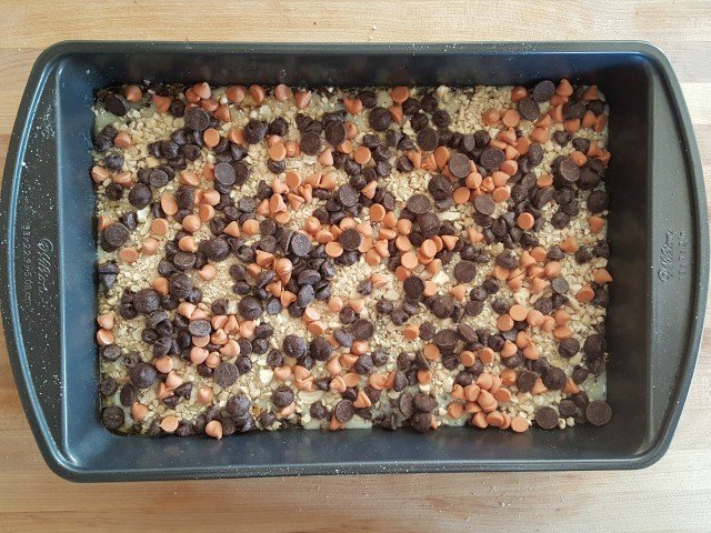 Add chocolate and butterscotch chips to gluten free magic dream bars