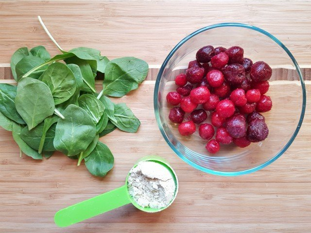 Cherries spinach and protein powder for a smoothie bowl recipe