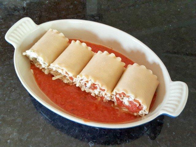 Add lasagna roll ups to dish to bake