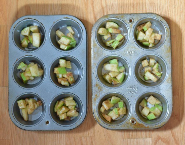 Add chopped apples to muffin tins
