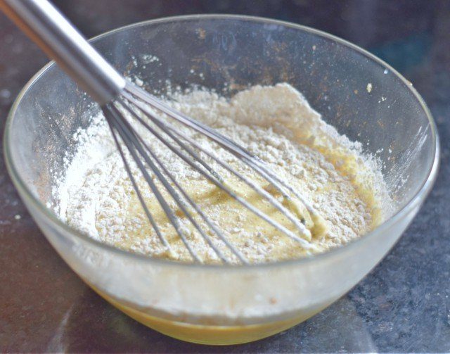 Whisk flour into eggs and milk