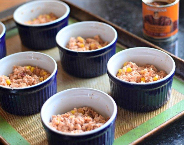 Add tamale filling to ramekins